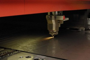 Laser cutting metal sheet in manufacturing industry